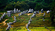 Carnac, Brittany, France. The Kermario group of prehistoric stone row alignments looking southwest toward the tallest