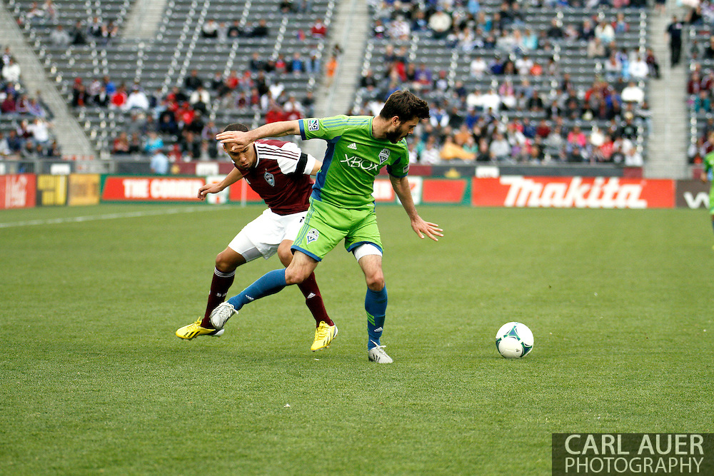 April 20th, 2013 Commerce City, CO - Seattle Sounders FC midfielder Brad Evans (3) and Colorado Rapids defender Chris Klute (15) fight for control of the ball in the second half of action in the MLS match between the Seattle Sounders FC and the Colorado Rapids at Dick's Sporting Goods Park in Commerce City, CO