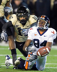Wake Forest cornerback Brandon Ghee (17) breaks up a deep pass intended for Virginia wide receiver Jared Green (84).  The Wake Forest Demon Deacons defeated the Virginia Cavaliers 24-17 in NCAA Division 1 Football at BB&T Field on the campus of Wake Forest University in Winston-Salem, North Carolina on November 8, 2008.