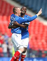 Rangers v St Mirren<br /> Scottish Cup Semi Final<br /> Hampden Park<br /> Glasgow<br /> 25th April 2009<br /> <br /> Kenny Miller celebrates his goal with Maurice Edu<br /> <br /> Ian MacNicol - Colorsport<br /> <br /> Email: info@colorsport.co.uk<br /> Telephone: 01306 712233<br /> Fax: 01306 712260<br /> <br /> Address<br /> The Old Sawmill<br /> Rusper Road<br /> CAPEL<br /> Surrey<br /> RH5 5HF<br /> <br /> Registration: registration@colorsport.co.uk<br /> Sales: sales@colorsport.co.uk<br /> Enquiries: ask@colorsport.co.uk