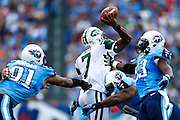NASHVILLE, TN - SEPTEMBER 29:  Geno Smith #7 of the New York Jets is hit while throwing a pass by Jurrell Casey #99 of the Tennessee Titans at LP Field on September 29, 2013 in Nashville, Tennessee.  (Photo by Wesley Hitt/Getty Images) *** Local Caption *** Geno Smith; Jurrell Casey