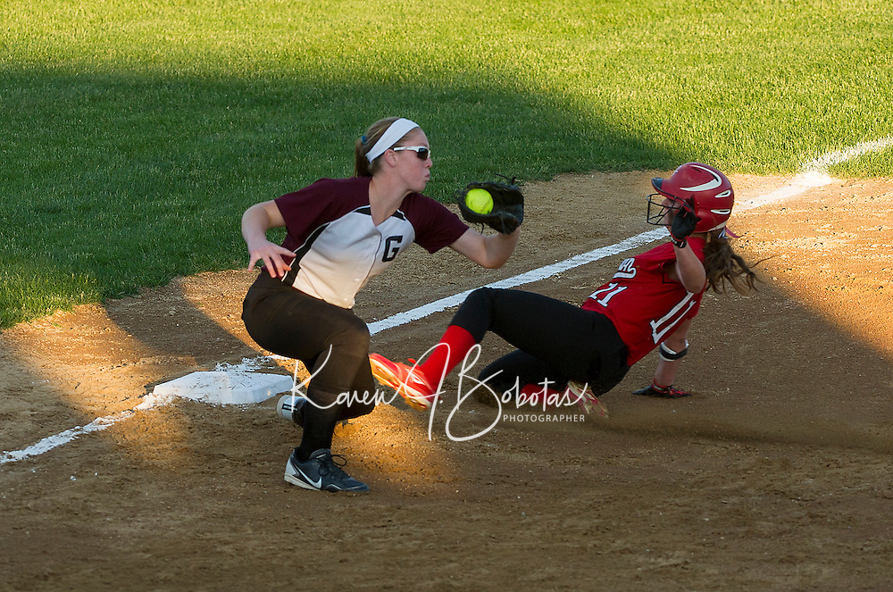 Coe Brown's Lauren Jones gets safetly to third ahead of Nicole Nanof's tag during NHIAA Division II Softball against Goffstown Tuesday evening.  (Karen Bobotas/for the Concord Monitor)