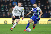 Derby County midfielder Harry Wilson runs with the ball as Wigan Athletic midfielder Sam Morsy challenges during the EFL Sky Bet Championship match between Derby County and Wigan Athletic at the Pride Park, Derby, England on 5 March 2019.