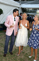 EDWARD TAYLOR and MARTHA WARD at the Concervative Party Summer Party held in the gardnes of The Royal Hospital, Chelsea, London on 3rd July 2006.<br />