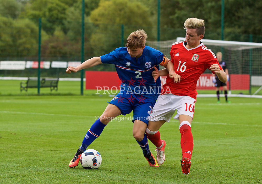 NEWPORT, WALES - Tuesday, September 6, 2016: Wales' Aaron Lewis in action against Iceland's captain Alfons Hampstead during the International Friendly match at Dragon Park. (Pic by David Rawcliffe/Propaganda)