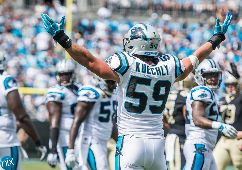 Carolina Panther Luke Kuechly (59) gets the crowd to make noise against the New Orleans Saints at Bank of American Stadium on Sunday, September 24, 2017 in Charlotte, NC.