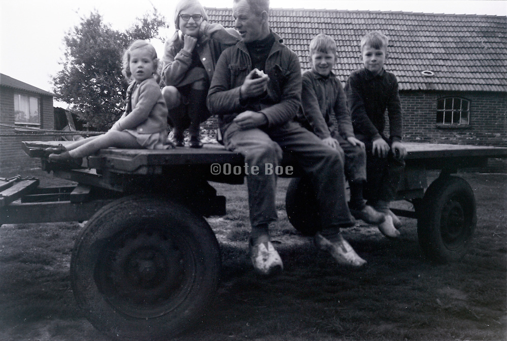 father with children on a horse pulled cart 1960s