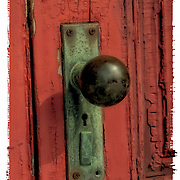 Polariod transfer of 19th Century door knob handle on abandon building,  weathered door with pealing paint.