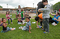 Woodland Heights Elementary students, faculty and parents enjoyed a cookout on the lawn served by Laconia Fire and Police on Friday afternoon.   (Karen Bobotas/for the Laconia Daily Sun)