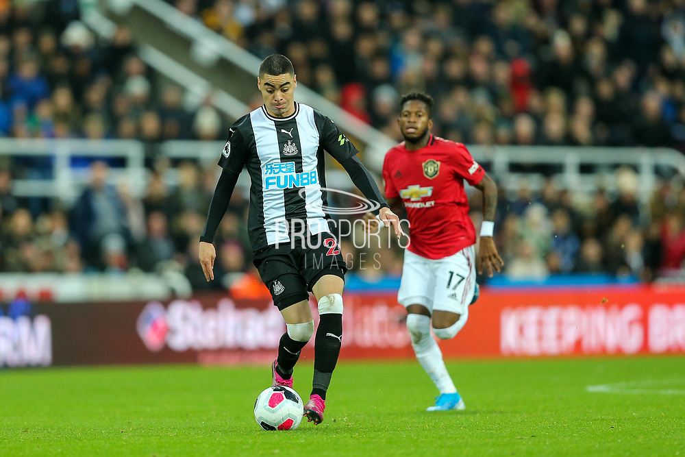 Miguel Almiron (#24) of Newcastle United breaks down field with the ball pursued by Fred (#17) of Manchester United during the Premier League match between Newcastle United and Manchester United at St. James's Park, Newcastle, England on 6 October 2019.