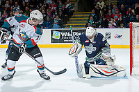 KELOWNA, CANADA -FEBRUARY 10: Taran Kozun #35 of the Seattle Thunderbirds makes a save on a shot from Rourke Chartier #14 of the Kelowna Rockets on February 10, 2014 at Prospera Place in Kelowna, British Columbia, Canada.   (Photo by Marissa Baecker/Getty Images)  *** Local Caption *** Taran Kozun; Rourke Chartier;