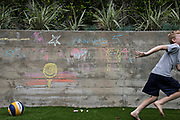 "A wall in her backyard, boasts of fresh chalk art — drawings the kids did, and the words ""Jennings 5"" that Kerri wrote."