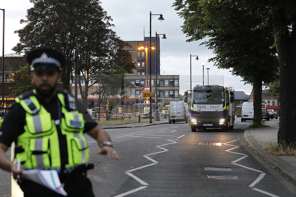© Licensed to London News Pictures. 19/06/2018. London, UK. Emergency vehicles are seen near Southgate Underground station. Police were called earlier to reports of a suspicious package. Injuries are being reported. Adjacent stations are closed. Photo credit: Tolga Akmen/LNP