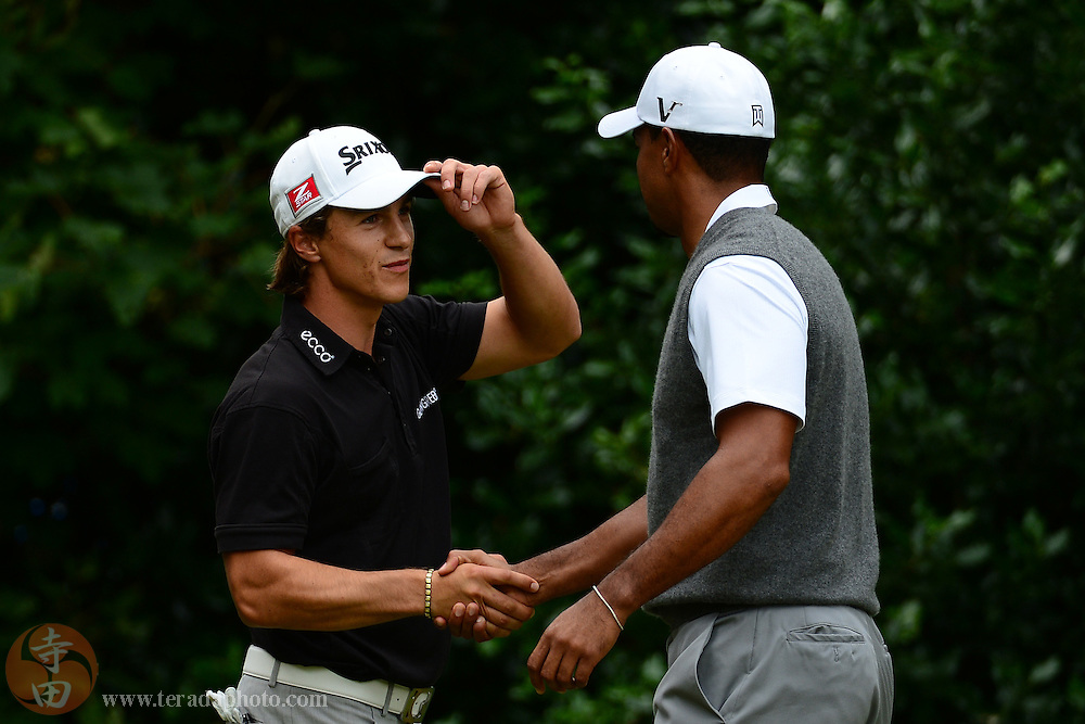 July 21, 2012; St. Annes, ENGLAND; Thorbjorn Olesen (left) shakes hands with Tiger Woods (right) on the 1st tee during the third round of the 2012 British Open Championship at Royal Lytham & St. Annes Golf Club.