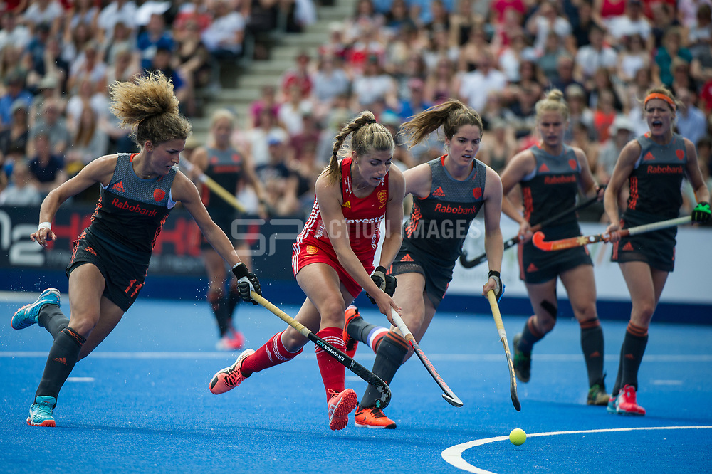 England's Sarah Haycroft drives into the dutch circle past Maria Verschoor. England v The Netherlands, Lee Valley Hockey and Tennis Centre, London, England on 11 June 2017. Photo: Simon Parker