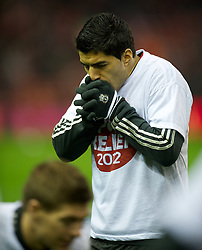 LIVERPOOL, ENGLAND - Tuesday, March 13, 2012: Liverpool's Luis Alberto Suarez Diaz warms-up with a Sport Relief t-shirt before the Premiership match against Everton at Anfield. (Pic by David Rawcliffe/Propaganda)