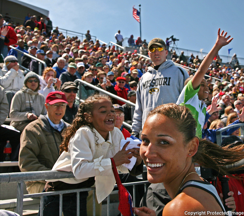 Special 100 meter hurdle winner LoLo Jones interacted with the crow after her win at Drake.  photo by David Peterson