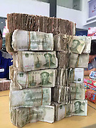 ZHANJIANG, CHINA - JANUARY 11: (CHINA OUT) <br /> <br /> Tremendous Amount Of Money To Buy Van <br /> <br /> RMB One yuan notes brought by a citizen who saves 100,000 yuan notes to buy a van are seen at a 4S store on January 11, 2016 in Zhanjiang, Guangdong Province of China. The citizen drove a small truck to carry these notes whose denominations are mostly RMB five Jiao, RMB two Jiao, RMB one Jiao and a small fraction of RMB one Yuan. It\'s said that the van the citizen wants to purchase costs more than ninety thousand and he paid for it in lump sum. <br /> ©Exclusivepix Media