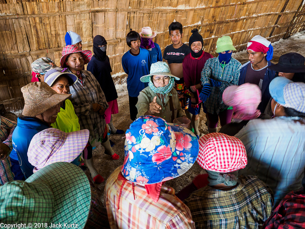 28 MARCH 2018 - BAN LAEM, PHETCHABURI, THAILAND: Workers get their assignments before their shift during the 2018 salt harvest in Petchaburi province, about two hours south of Bangkok. Sea salt is made in provinces south of Bangkok by flooding fields with ocean water after the rainy season. As the fields dry out from evaporation, workers go into the fields and gather the salt left behind.          PHOTO BY JACK KURTZ