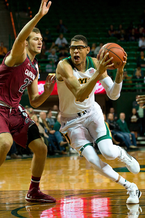WACO, TX - NOVEMBER 12: Isaiah Austin #21 of the Baylor Bears drives to the basket against the South Carolina Gamecocks on November 12, 2013 at the Ferrell Center in Waco, Texas.  (Photo by Cooper Neill/Getty Images) *** Local Caption *** Isaiah Austin