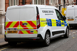 © Licensed to London News Pictures. 28/07/2019. London, UK. A forensic services van parks near a crime scene on Savoy Hill after a man suffered stab wounds during a mass brawl on Victoria Embankment in the early hours of this morning. One man was arrested for possession of an offensive weapon while five other men were arrested for violent disorder . Photo credit: George Cracknell Wright/LNP