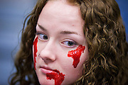 27 MAY 2011 - PHOENIX, AZ: KIERSTY BARTSCH, from Mesa, AZ, waits for the Zombie Walk to start at the Phoenix Comicon Friday. Phoenix Comicon opened Thursday and featured a Zombie Walk through downtown Phoenix Friday night. Hundreds of people participated in the Zombie Walk, both as Zombies and as Zombie hunters. This year's Comicon includes appearances by Leonard Nimoy (Star Trek), Adam Baldwin (Firefly and Chuck), Stan Lee (Marvel Comics), Nicholas Brendon (Buffy the Vampire Slayer) and others. Activities include costuming workshops, role playing games and a Geek Prom.     Photo by Jack Kurtz