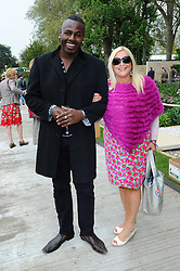 Vanessa Feltz & Ben Offiedu at the opening of the Chelsea Flower  Show, Monday, 21st May 2012  Photo by: Chris Joseph / i-Images