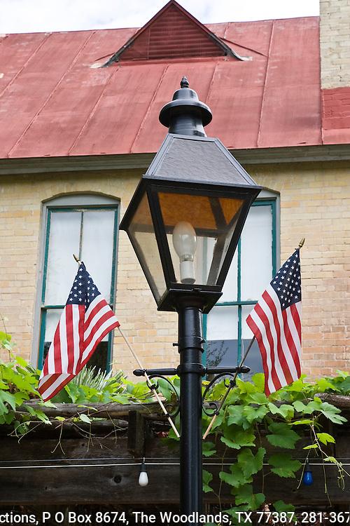 American flags adorn a street lamp in the La Villita Shopping area in San Antonio.
