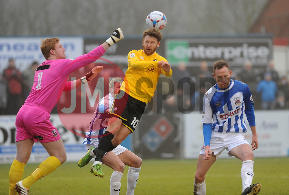 Nuneaton Town's Christian Dibble punches clear from Bristol Rovers' Matty Taylor- Photo mandatory by-line: Neil Brookman/JMP - Mobile: 07966 386802 - 04/01/2015 - SPORT - football - Nuneaton - James Parnell Stadium - Nuneaton Town v Bristol Rovers - Vanarama Conference