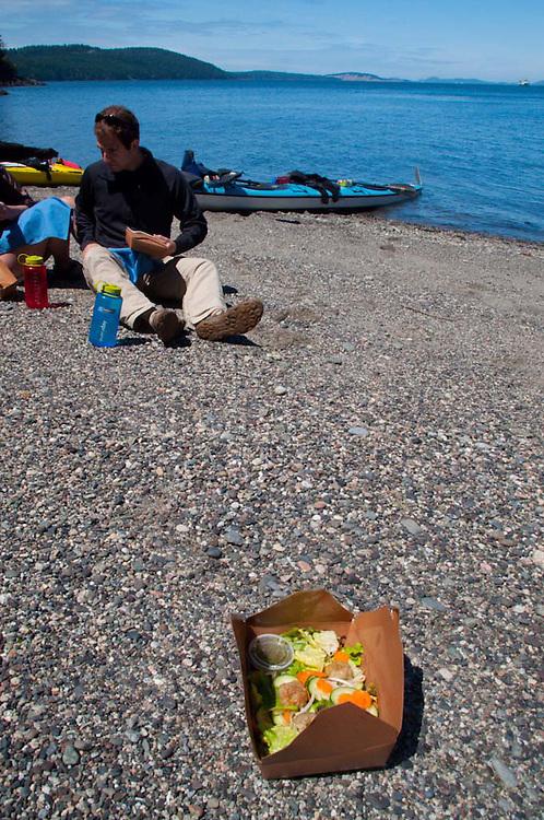 Enjoying Vietnamese Salads with Shrimp Meatballs on Empty Beach, San Juan Island, Washington, US