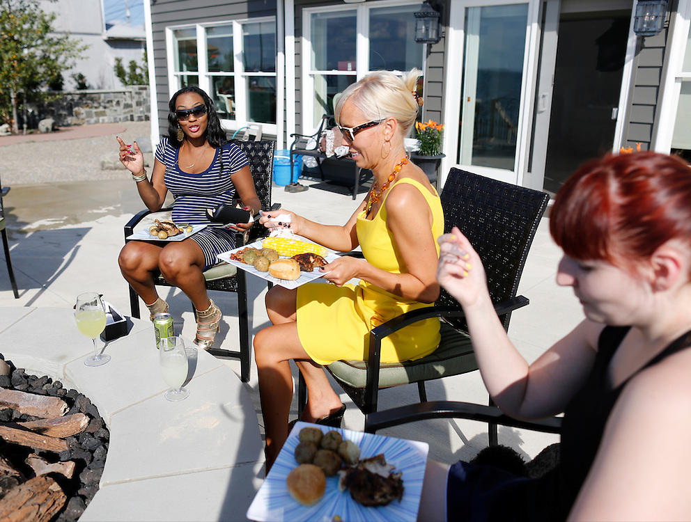 Gwen McQuiller, Leanne Powers, and Ashley Herrmann have dinner at a party hosted by Powers at her home in Blasdell, N.Y. on August 24, 2014. Powers has been forced to cut back on some of her dinner offerings due to food price increases. CREDIT: Mike Bradley for the Wall Street Journal<br /> PRICES
