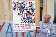 """Roma 10 Settembre 2015<br />  I tassisti romani protestano davanti a piazza Montecitorio per chiedere la cancellazione degli emendamenti presentati da alcuni deputati  a favore della multinazionale americana Uber. I tassisti denunciano  che il vice Presidente di Uber e il nuovo manager per l'Italia, sono stati avvistati in mattinata a palazzo Chigi sede del Governo Renzi e nella  sede del Partito Democratico.<br /> Rome September 10, 2015<br /> The Roman taxi drivers are protesting in front of Piazza Montecitorio to ask the cancellation of the amendments tabled by Members in favor of the American multinational Uber. A poster of the movie """"A Fistful of Dollars"""" with a picture of Prime Minister Matteo Renzi and David Plouffe  the Senior Vice President of Policy and Strategy for transportation network company startup Uber."""