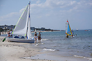 Scenes from Tunisia's resort area, El Kantouai, windsurf and sailboats on beach