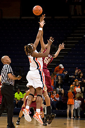 Virginia center Aisha Mohammed (33) and Florida St. forward/center Jacinta Monroe (50) leap for the open tip off.  The Virginia Cavaliers women's basketball team hosted the Florida State Seminoles at the John Paul Jones Arena in Charlottesville, VA on February 10, 2008.