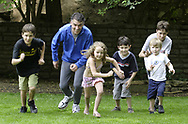 (left to right) Will Beyer, 10; Jim; Lydia, 5; Jack, 7; Dane Wertz, 4 and Hank, 12 race in the back yard, Saturday, May 26th