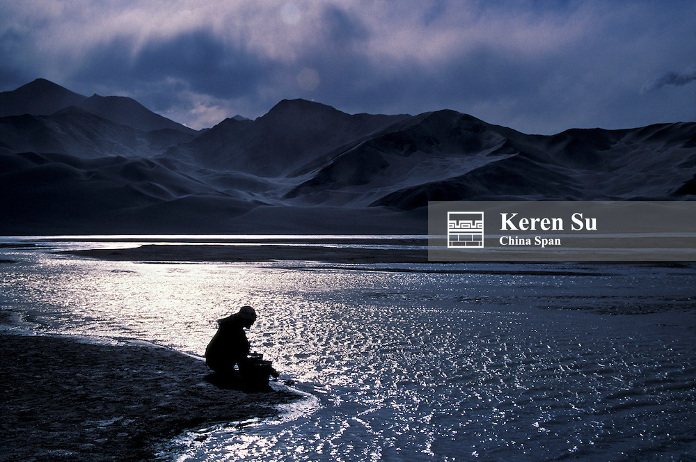 Uighur woman fetching water from Karakuli Lake, Pamir Plateau, Xinjiang Province, Silk Road, China