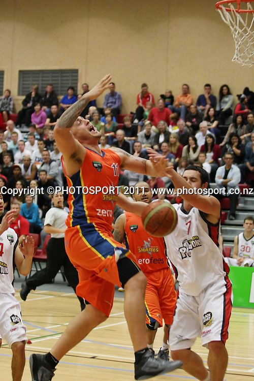 Sharks Brendon Polyblank loses the ball to some big defense from Pistons James Comer during their NBL Game in Hamilton,Basketball,Pistons Vs Sharks, Wednesday 11 May 2011.<br /> Photo: Dion Mellow / photosport.co.nz