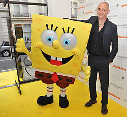 DINOS CHAPMAN and SpongeBob SquarePants at a party to launch a range of SpongeBob SquarePants suits and accessories designed by Richard James in partnership with Nickelodeon held at Richard James, 29 Savile Row, London W1 on 11th May 2011.