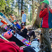 The group takes a break along the 10 mile hike and 4000 vertical foot climb to the Sperry Chalet.