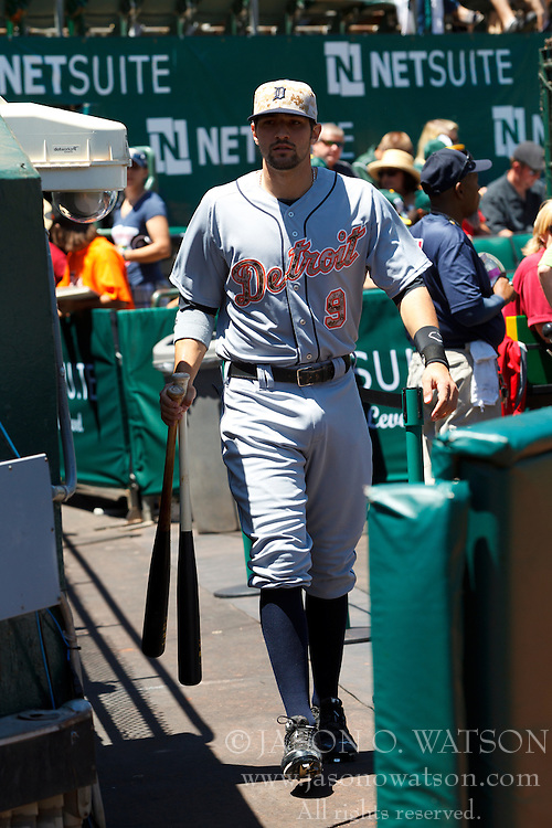 OAKLAND, CA - MAY 26:  Nick Castellanos #9 of the Detroit Tigers enters the dugout before the game against the Oakland Athletics at O.co Coliseum on May 26, 2014 in Oakland, California. The Oakland Athletics defeated the Detroit Tigers 10-0.  (Photo by Jason O. Watson/Getty Images) *** Local Caption *** Nick Castellanos