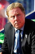 Queens Park Rangers Manager Harry Redknapp looks on before kick off .Skybet football league championship match , Queens Park Rangers v Blackpool at Loftus Road in London  on Saturday 29th March 2014.<br /> pic by John Fletcher, Andrew Orchard sports photography.