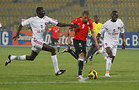 Photo: Steve Bond/Richard Lane Photography.<br />Egypt v Sudan. Africa Cup of Nations. 26/01/2008. Mohamed Zidan (C) tries to burst through, pursued by Alaeldin Ahmed (L) and Alaeldin Yousif (R)