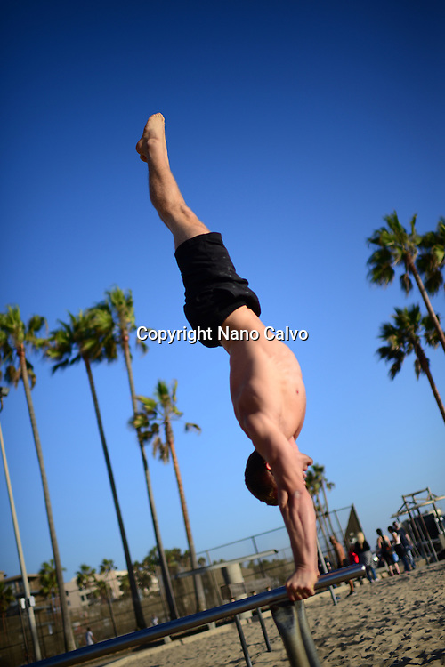 Finnish athlete and coach, Aaro Helander, practicing in Venice Beach Calisthenics park, Los Angeles.
