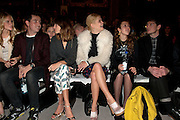 Pixie Geldof (Left )white coat and Alexa Chung (Right) House of Holland front row on February 18th 2012...Day 2 of London Fashion Week..
