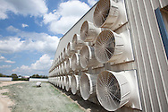 Large fans draw air through the hen house at Pearl Valley Egg Farm in Kent, Illinois..