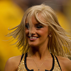 2009 October 18: A New Orleans Saints Saintsations cheerleader performs on the field during a 48-27 win by the New Orleans Saints over the New York Giants at the Louisiana Superdome in New Orleans, Louisiana.