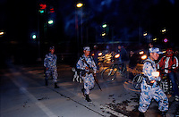 Kathmandu, 15 February 2005.  Armed Police Forces patrolling the street of the capital. Since the King's declaration of the 'state of emergency' the Police operate under the Royal Nepal Army's orders.