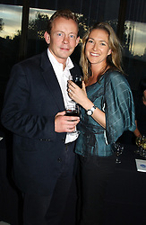 Chief Executive of Pizza Express HARVEY SMYTH and his fiance KATE BUNNING at a concert performance of Death in Venice by Benjamin Britten in aid of The Venice in Peril Fund held at the Queen Elizabeth Hall, London on 30th June 2004.  Before the concert a cheque for 1 Million Pounds was presented by Pizza Express to the The Venice in Peril Fund.
