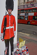 Calvin Klein male model and Coldstream guardsman appear on a poster outside a tourist shop in central London. Located on a street corner near the British Museum in central London, we see these iconic symbols for Britishness, for the tourism industry and for Britian's UK identity.