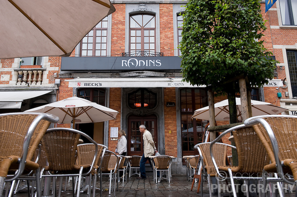 Pedestrians walk past the trendy Rodins restaurant and bar, on the Oude Markt, in Leuven, Belgium, Saturday, Sept. 13, 2008.  (Photo © Jock Fistick)
